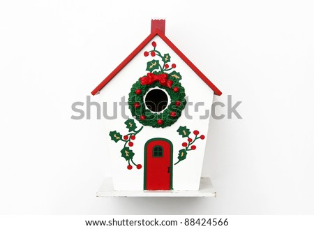 Festive Winter Birdhouse with wreath and Holly isolated on white background - stock photo