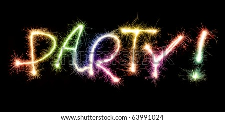 Festive word party created from burning sparklers isolated on black - stock photo