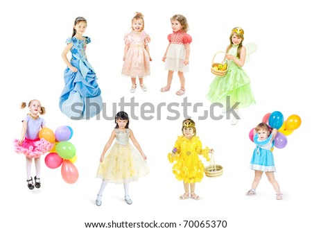 Festively dressed children stand on a white background