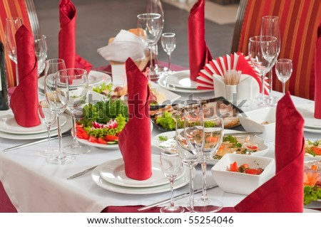 Festively served table at restaurant for a banquet. - stock photo