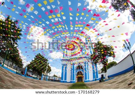 Festoons in the entrance of a Church, San Cristobal de las Casas, Mexico. - stock photo