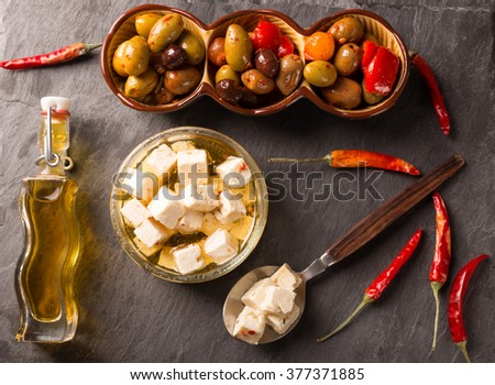 Feta Cheese and Olives on wooden background - stock photo