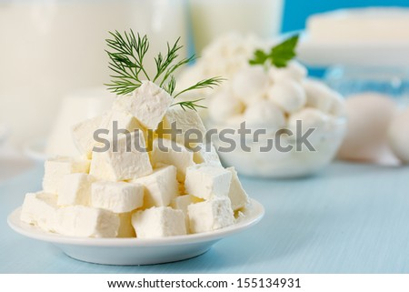 Feta cheese cut into slices on a plate - stock photo