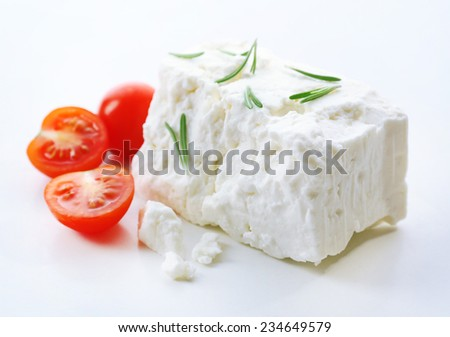 Feta cheese isolated on white - stock photo