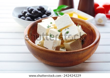 Feta cheese on table - stock photo