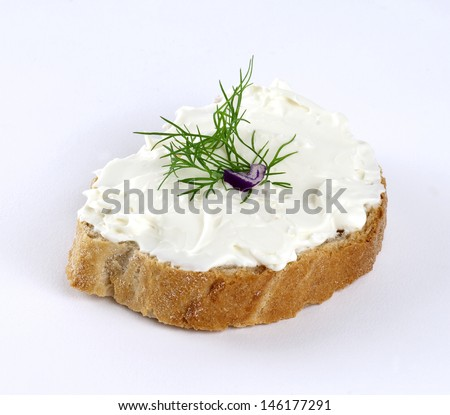feta cheese spread with dill on a slice of bread - stock photo