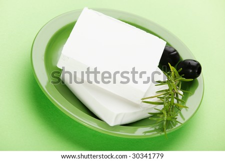 Feta cheese with olive - stock photo