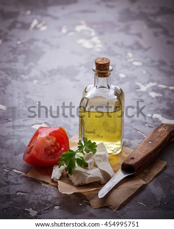 Feta cheese with tomato and oil. Selective focus, toned - stock photo