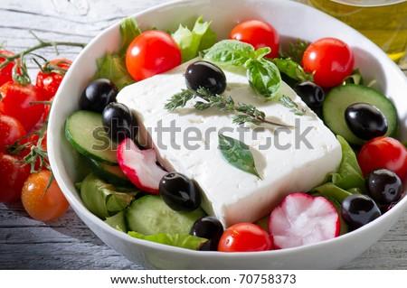 feta traditional greek cheese over greek salad - stock photo