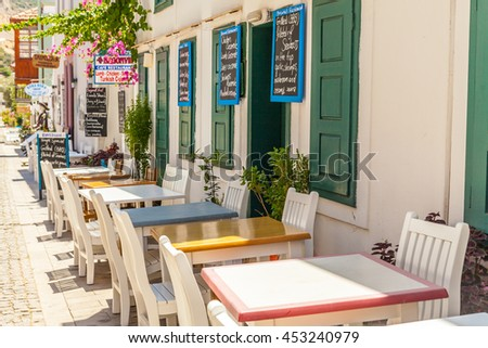 Fethiye - June 07: Tables and chairs of restaurant on the street. Fethiye, Turkey, June 7, 2016