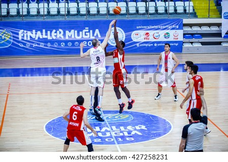Fethiye, Turkey - April 30, 2016 : Basketball players are playing during the Unilig University summer competitions on April 30, 2016 in Fethiye, Turkey.  - stock photo