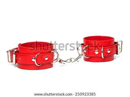 Fetish Hand cuffs made of red leather for BDSM  - stock photo