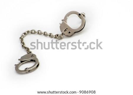 fetish handcuffs earrings - stock photo