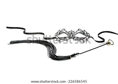 Fetish mask in venetian style and whip  - stock photo
