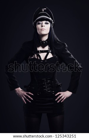Fetish model dressed in a corset with elements of historical military uniforms - stock photo