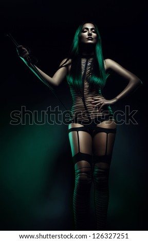 fetish woman with whip - stock photo