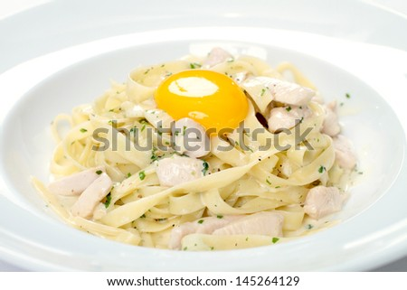 Fettuccine Alfredo with poached egg - stock photo
