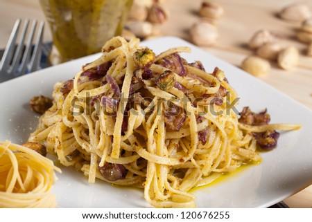 fettuccine pasta with pistachio pesto - stock photo