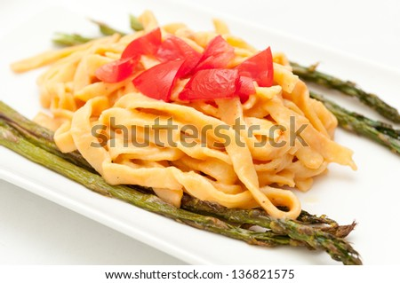 fettuccine primavera, creamy tomato sauce with asparagus and hand made pasta