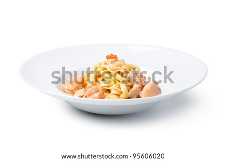 Fettuccine with salmon and caviar sauce, on a  White background