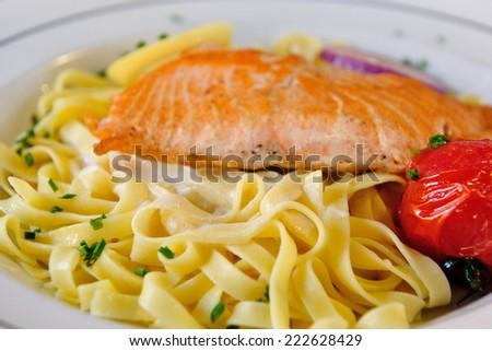 Fettucine with Salmon and Tomato - stock photo