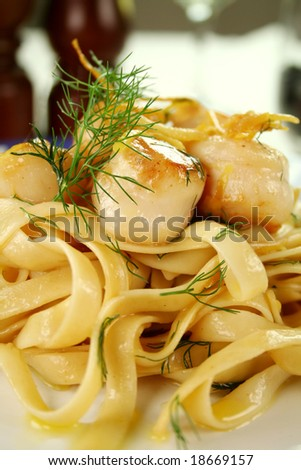 Fettucini with caramelized lemon and dill sea scallops.