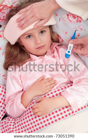 Fever - little girl with fever in the bed - stock photo