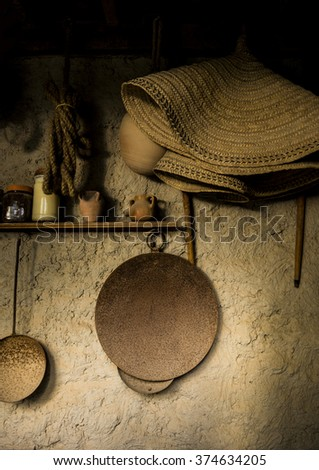Few ancient islamic kitchen utensils hanging on the wall. Middle eastern bedouins lifestyle. - stock photo