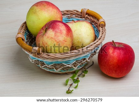 Few apples in the basket on wood backgrond