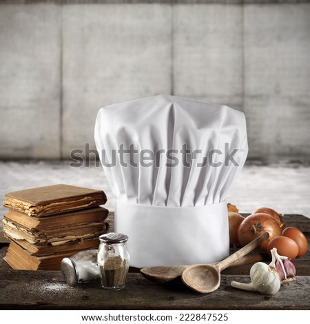 few books and cook hat  - stock photo