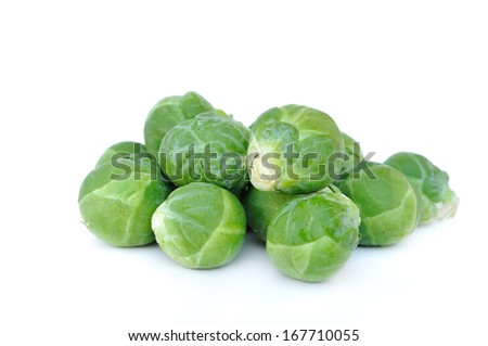 few brussels sprouts on white background