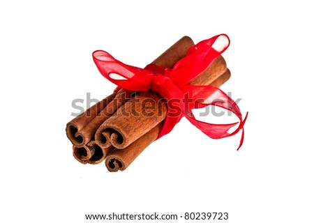 Few cinnamon sticks wrapped with a ribbon - stock photo