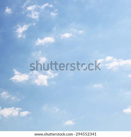 Few clouds in the sunny sky - stock photo