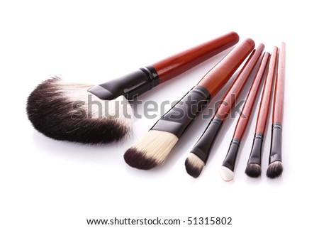 Few cosmetic brushes isolated on white