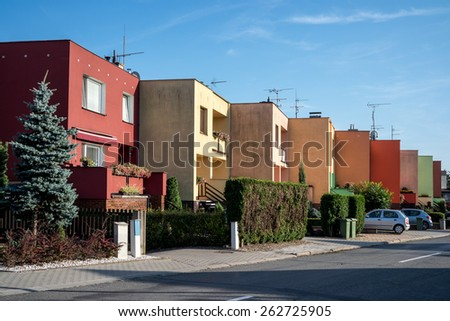 Few czech townhouses with blue sky at sunset - stock photo