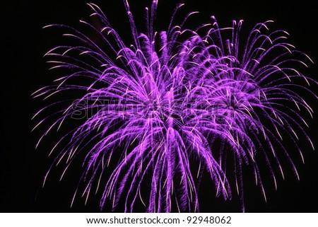 few fireworks blasts on black sky - stock photo