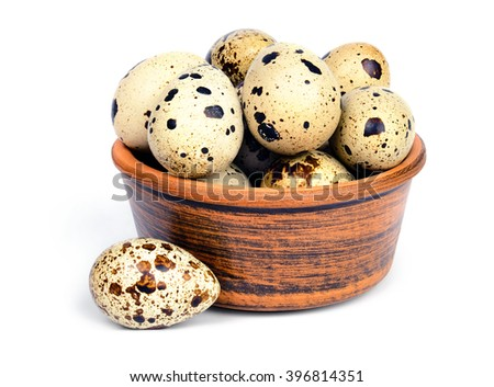 Few fresh quail eggs in a ceramic bowl isolated on white background. - stock photo