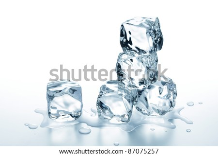few ice cubes stack on glass table