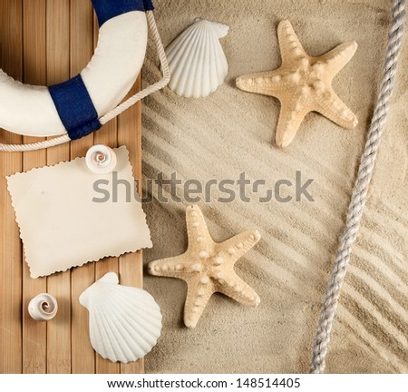 Few marine items on a sandy background. - stock photo