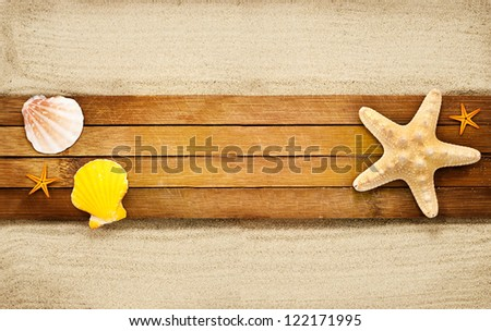 Few marine items on a wooden boards against sandy background. - stock photo