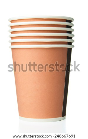 Few paper disposable cups on white background - stock photo