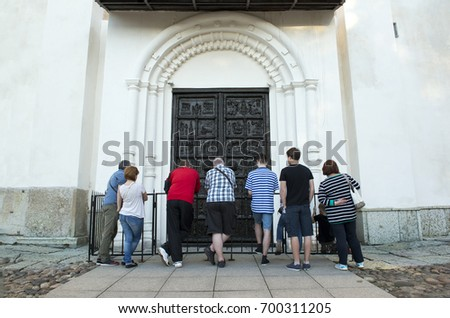 Few People Standing At The Metal Doors Of Orthodox Church Entry Into Jerusalem