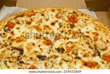 few pieces of hot pizza in box closeup - stock photo