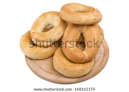 few pretzels on wooden board - stock photo