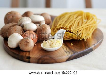 Few Raw Ingredients For Making Pasta, pasta tartufo  mushrooms and truffle butter - stock photo