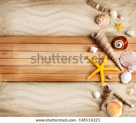 Few summer marine items on a sandy background. - stock photo