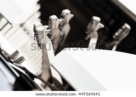 few typebars operates during fast typing on mechanical typewriter - stock photo
