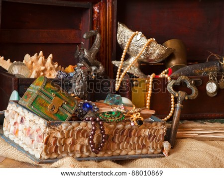 Few vintage treasure chests with old jewellery - stock photo