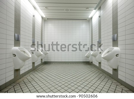 Few white urinals in toilet - stock photo