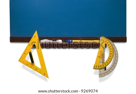 Few yellow rulers placed  near the deep-blue  blackboard. - stock photo